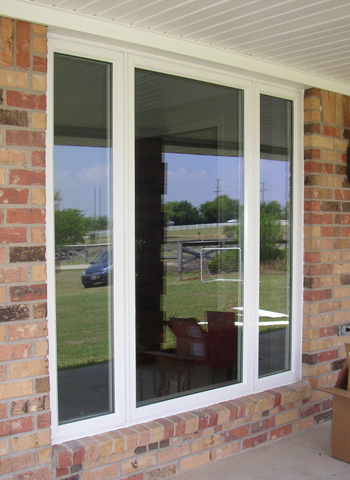 Three lite casement windows in place of twins.