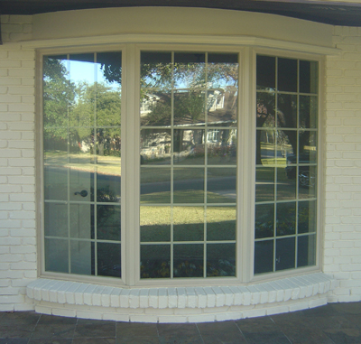 Wood Windows. Dallas has many historical and homeowners associations requiring wood windows with simulated or true divided lite grids