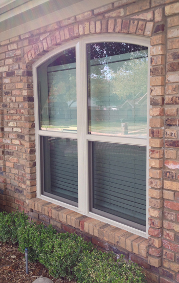 Wood Replacement windows have a special look due to the grids that pertrude from the surface of the glass.  This distictive look is now available in vinyl replacement windows as well.