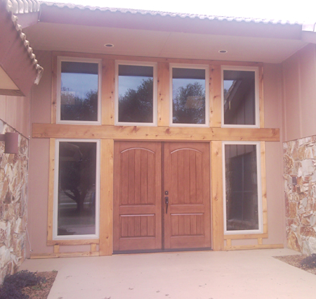 ThermaTru textured fiberglass doors with casement sidelites and transomes