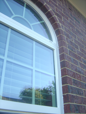 Simulated divided lite grids on vinyl replacement windows
