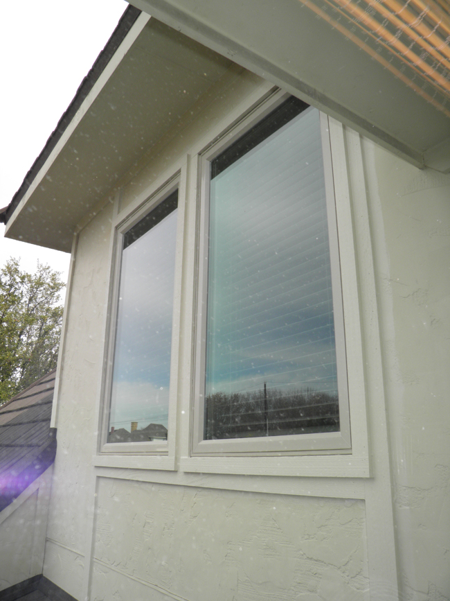 Casement Vinyl Windows provide ventilation by opening like a door with a screen on the inside.