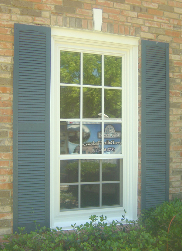 Wood Windows are often defined as windows with simulated divided lite grids.  These quality vinyl windows actually have the same look in a maintenence free exterior.  This product is often marketed as the Marquis Series in a triple pane but is also available as a double paned unit with a U Value in the .26 range