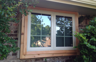 Twin casement window with colonial lite grids and cedar trim